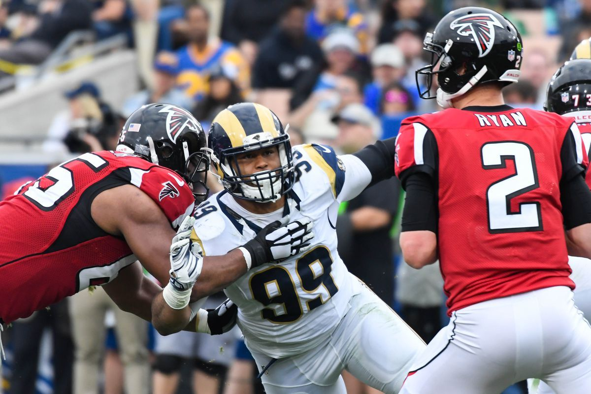 Falcons Beat Rams Advance To Play Eagles In Divisional Round Falcons Football Helmets Nfl Players