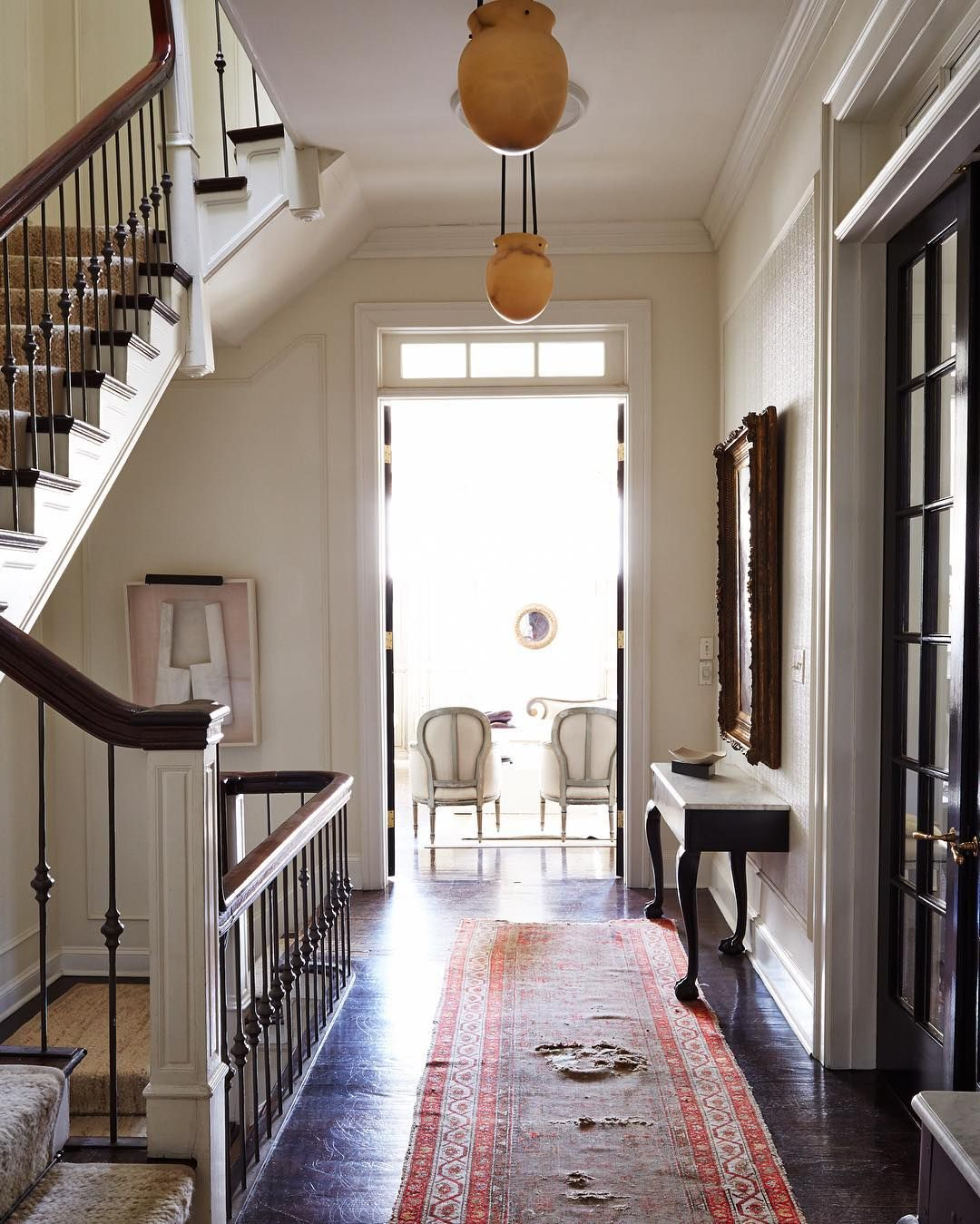 Cozy Lived In Entry Hall With Terracotta Pendant Lights And An Antique Runner
