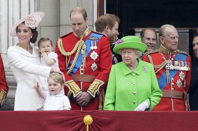 Britain's Queen Elizabeth II looks across the crowd with Prince Philip, right, Prince Will...