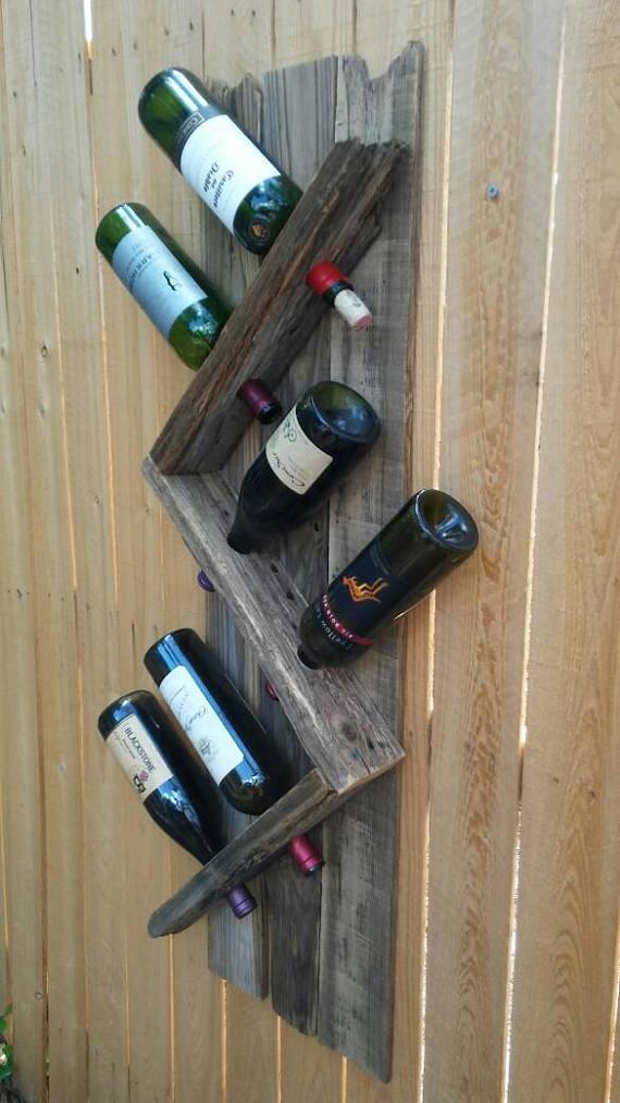 6 botellas de vino bastidor de reciclado cerca. Este estante del ...
