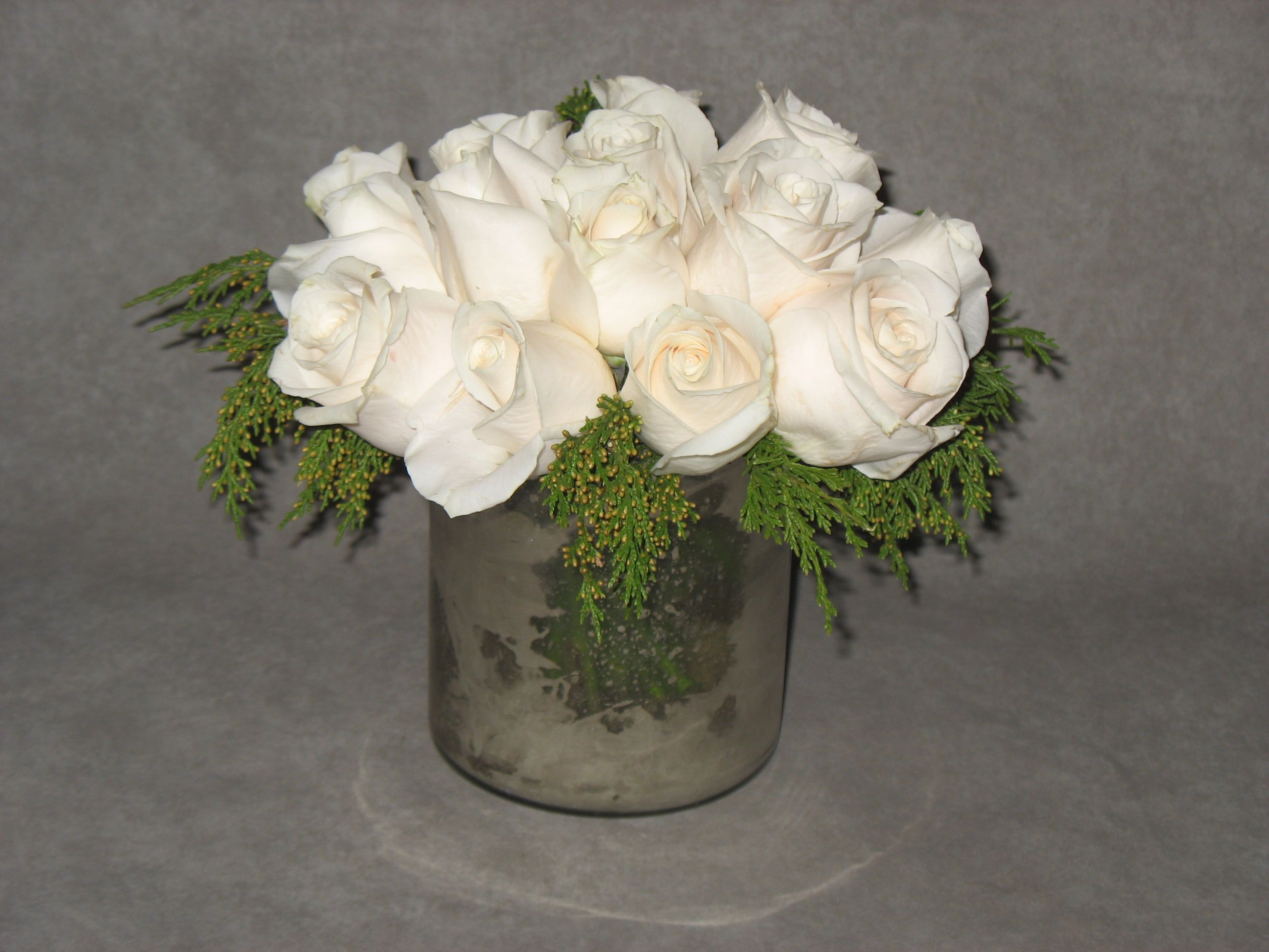 Beautiful and understated, classic white roses will never go out of style