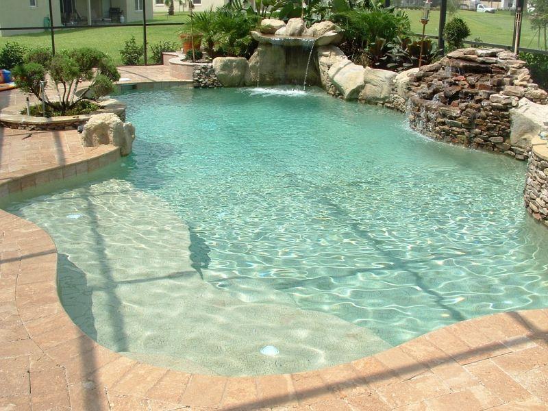 Freeform Pool Design Orlando Pool Design Windermere    Custom_lagoon_style_freeform_pool_with_sunshelf_natural_stone_and_pebble_interior