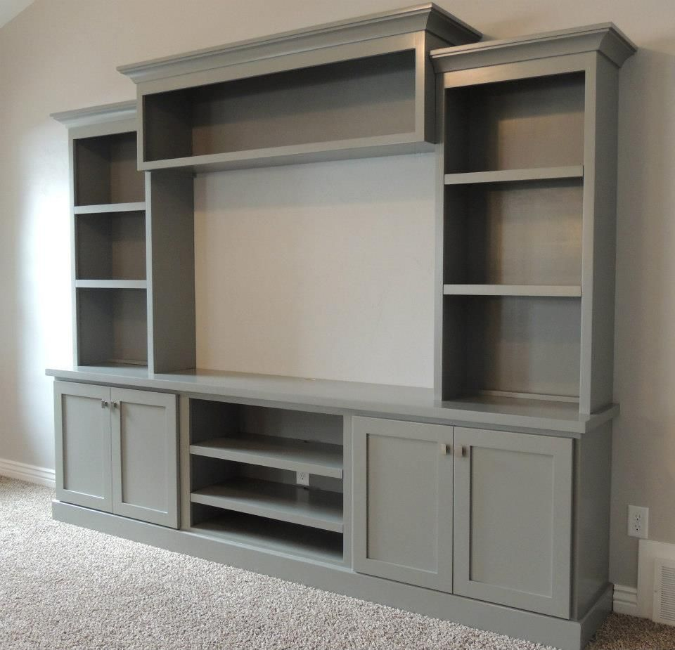 Family room with large painted entertainment center bing How to build an entertainment wall unit