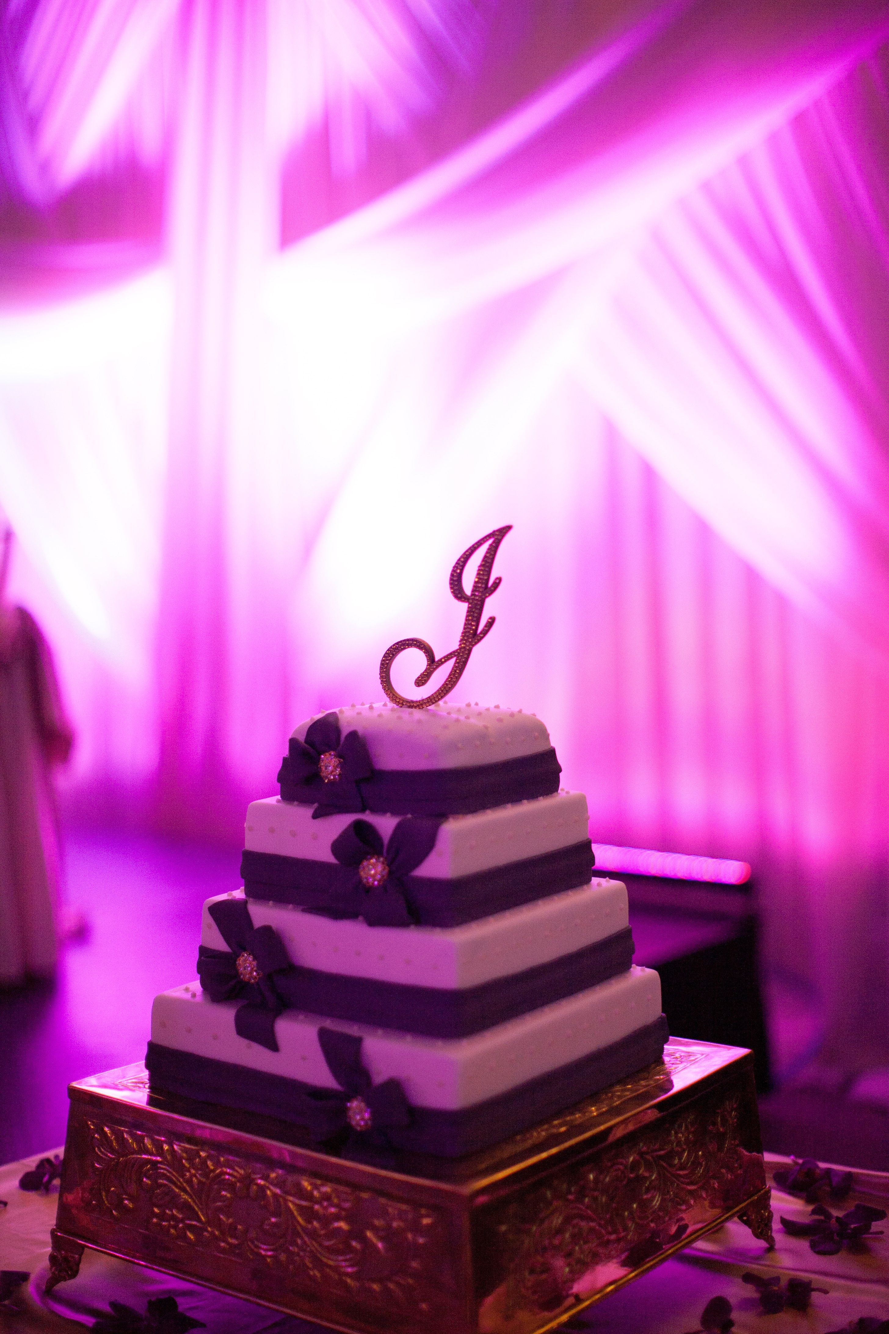 Using backdrop and uplighting to highlight the cake table http://www ...