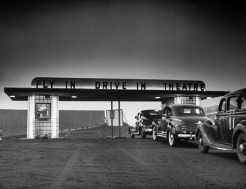"""Jetting in for a movie? A """"fly-in"""" drive-in theater for airplanes and cars, 1949. (Photo: Martha Holmes—Time & Life Pictures/Getty Images)"""