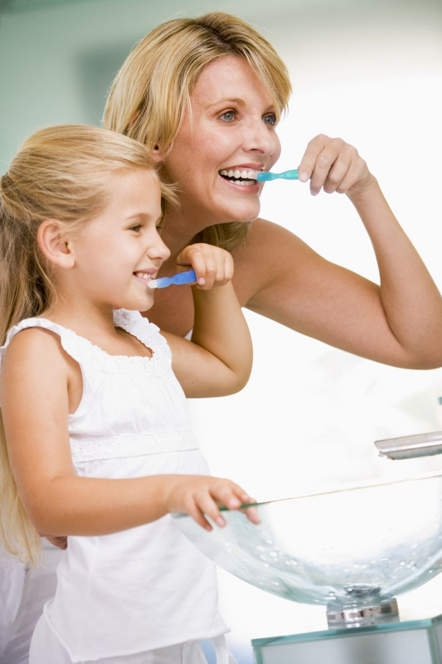 Bathroom sinkbrushing teethchilddaughterdayday in the