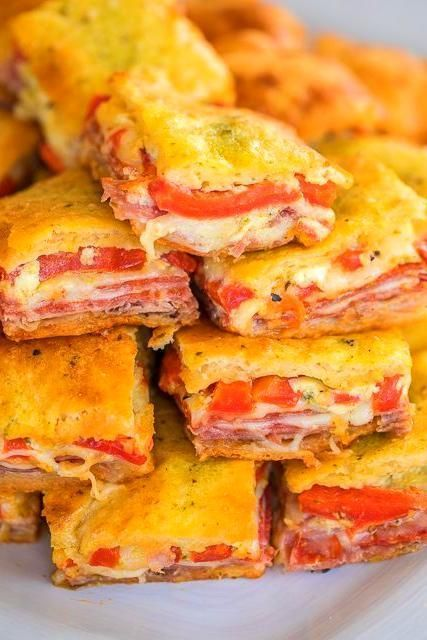 Appetizers For Party #antipastosquares Apps and Dips- baked  Antipasto Squares recipe - SO GOOD!! Crescent rolls stuffed with ham, salami, pepperoni, provolone, swiss, and roasted red peppers. then topped with a parmesan cheese, egg and pesto mixture and baked. These things are ridiculously good!!! There are never any leftovers when I take these to party! #antipastosquares Appetizers For Party #antipastosquares Apps and Dips- baked  Antipasto Squares recipe - SO GOOD!! Crescent rolls stuffed wit #antipastosquares