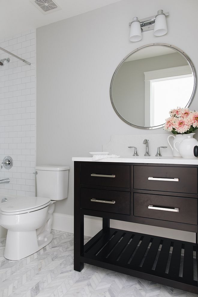 "This bathroom is a perfect combination of masculine and feminine with a dark wood cabinet from RH next to a Chevron Carrara marble floor Countertop Misty Carrera Honed Backsplash is 8"" tall with scallop edge #whitemarbleflooring"