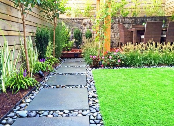 Like the large paver and river rock for off the low deck for Best back garden designs