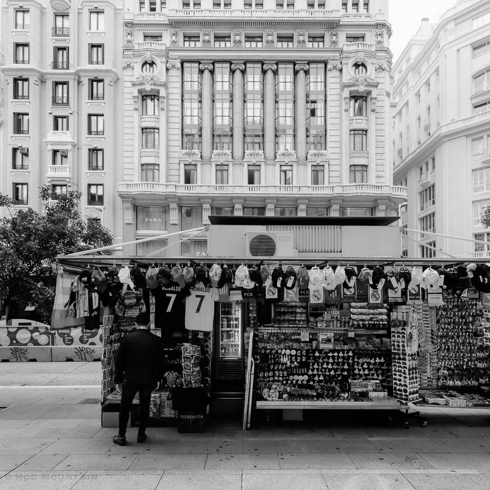 Madrid, Spain - Souvenir shop set up along Gran Vía.  Image: © Rod Mountain   Nikon D800 / Nikkor Lens   #streetphotography #souvenir #GranVia #Tourist #Madrid #Spain #TourismSpain #VisitSpain #NikonCA #NikonEurope #monoart #bnw_greatshots #loves_bnw #bnw_city #bnwmood #instapassport #earthofficial #mytravelgram #mytinyatlas #ig_masterpiece  #global_hotshotz #citykillerz #igersone #archilovers #icu_architecture #bnw_of_our_world #top_bnw #love_bnw #justgoshoot
