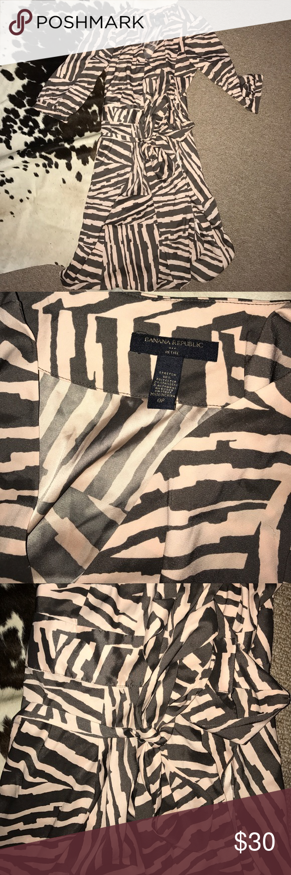 Banana republic zebra wrap dress 0p brown & pink No flaws. Great work dress. Has stretch to it. Wraps and ties at waist. 3/4 sleeve. Brown and pale pink color. Banana Republic Dresses