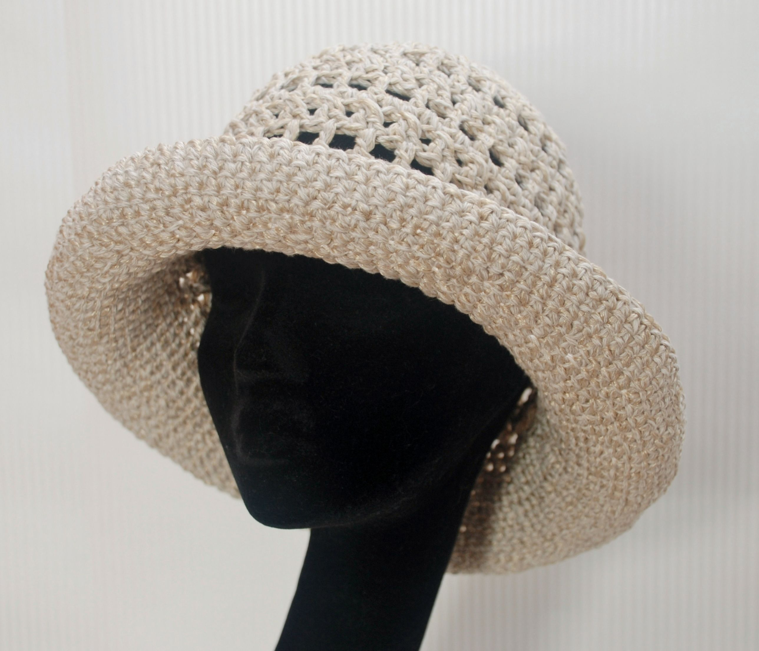 Wide brimmed summer hat crocheted in linen and egyptian cotton yarn