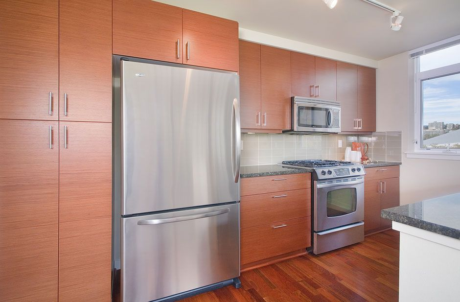 Contemporary Kitchen Cabinets In Horizontal Grain Quartered Cherry Echo Wood Veneer With Grey Subway Tile