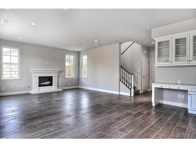 GREAT living room idea... big and open, tile wood floor ...