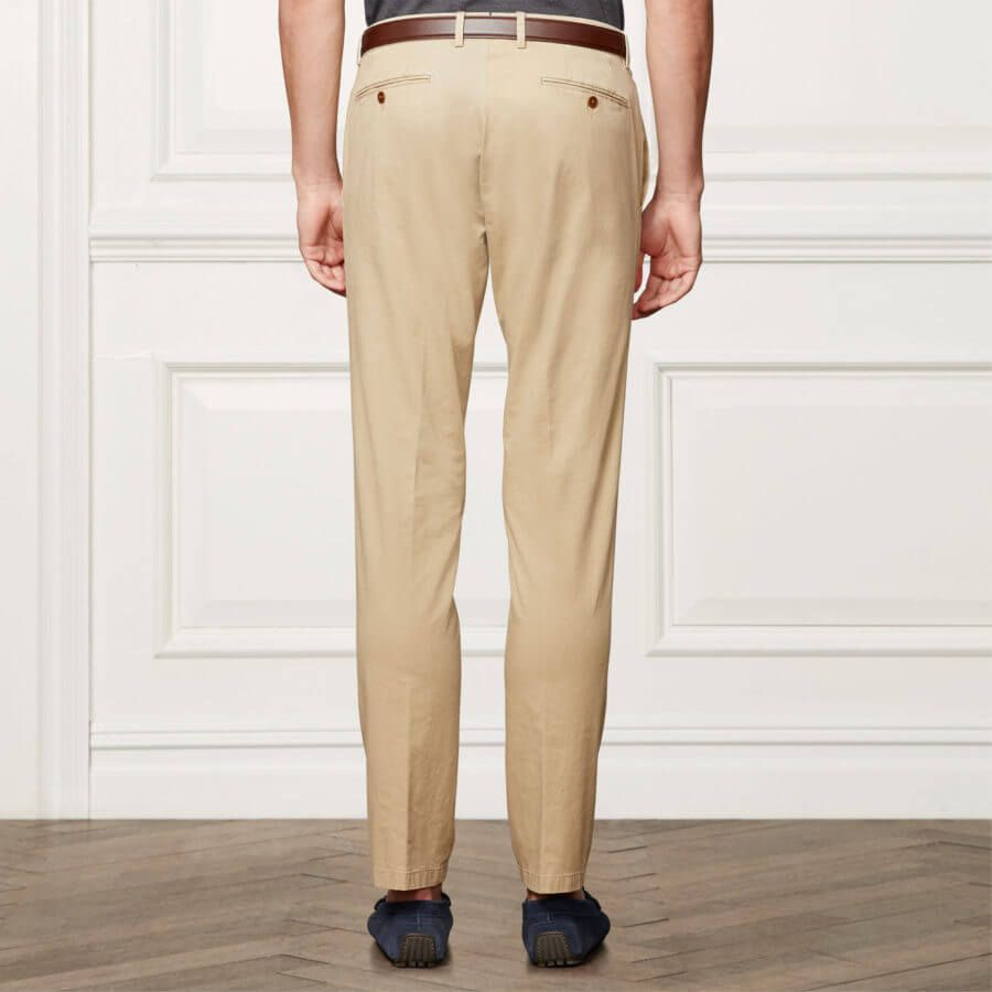 Classic Tan khakis with jetted back pocket with button and belt loops worn with driving mocs