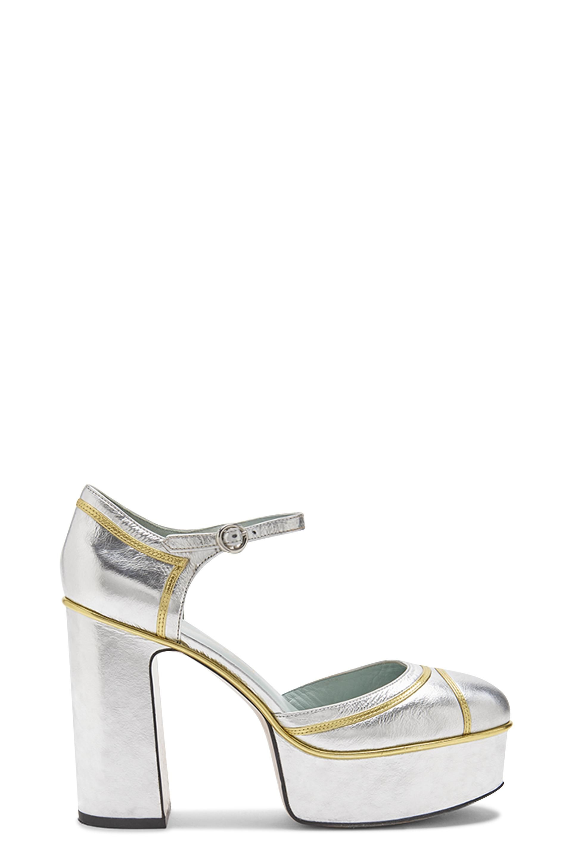 ac689cd9169 The Marc Jacobs Edie Mary Jane Platform Pump is crafted from smooth and  glossy patent goat leather and features an adjustable ankle strap. Heel   110MM ...
