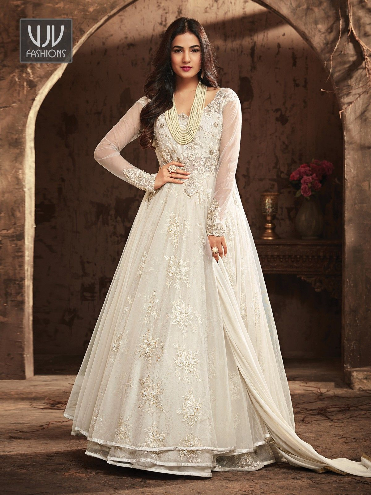 b81c75e8a1 Sonal Chauhan White Net Designer Anarkali Suit Make the heads flip whenever  you dress up in this white color net floor length anarkali suit.