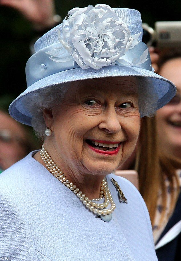 No wonder she's happy! Queen inspects the troops as she arrives for the start of her two month summer holiday at Balmoral