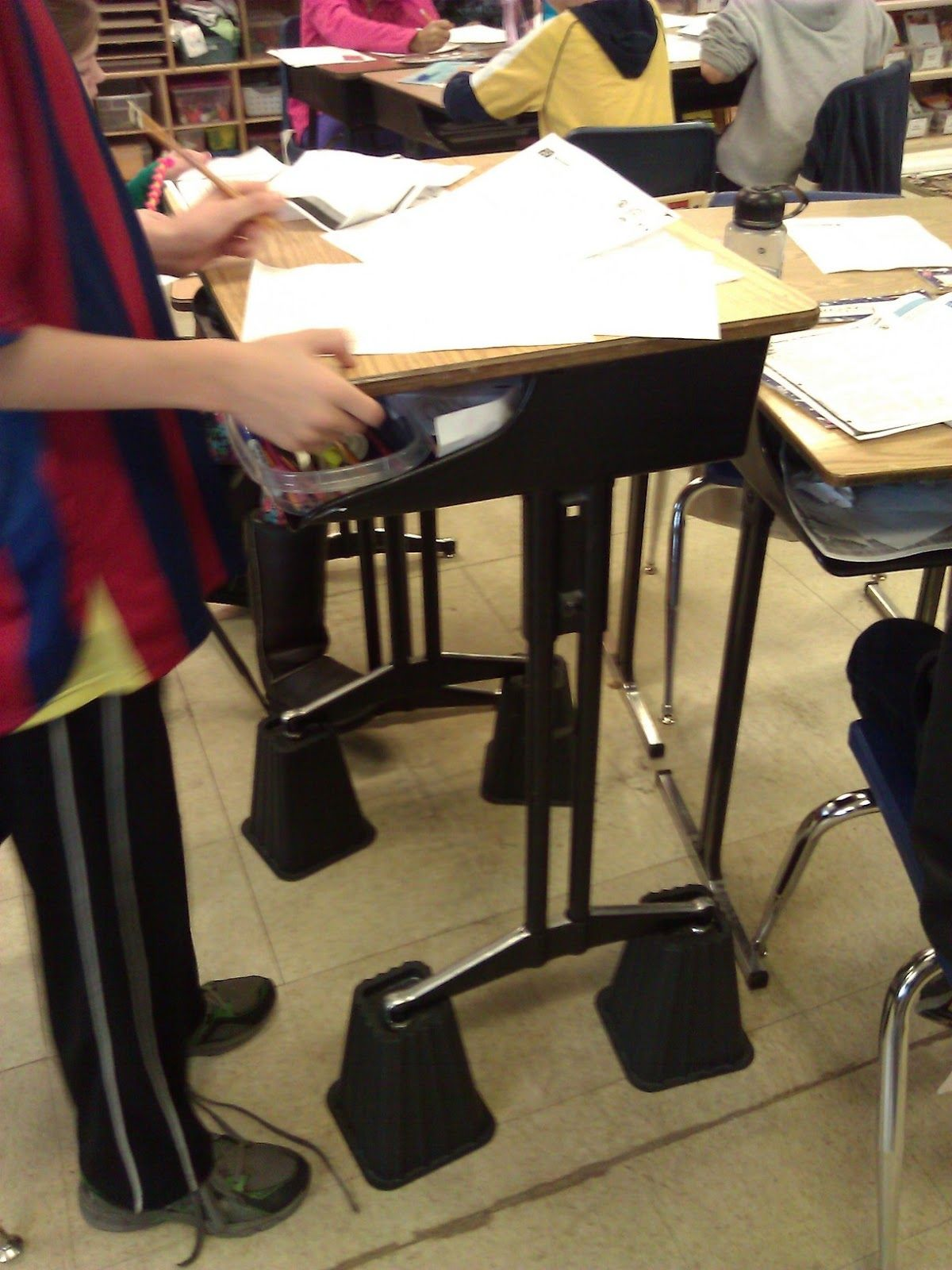Organizing Chaos in the Classroom Use bed risers to make a