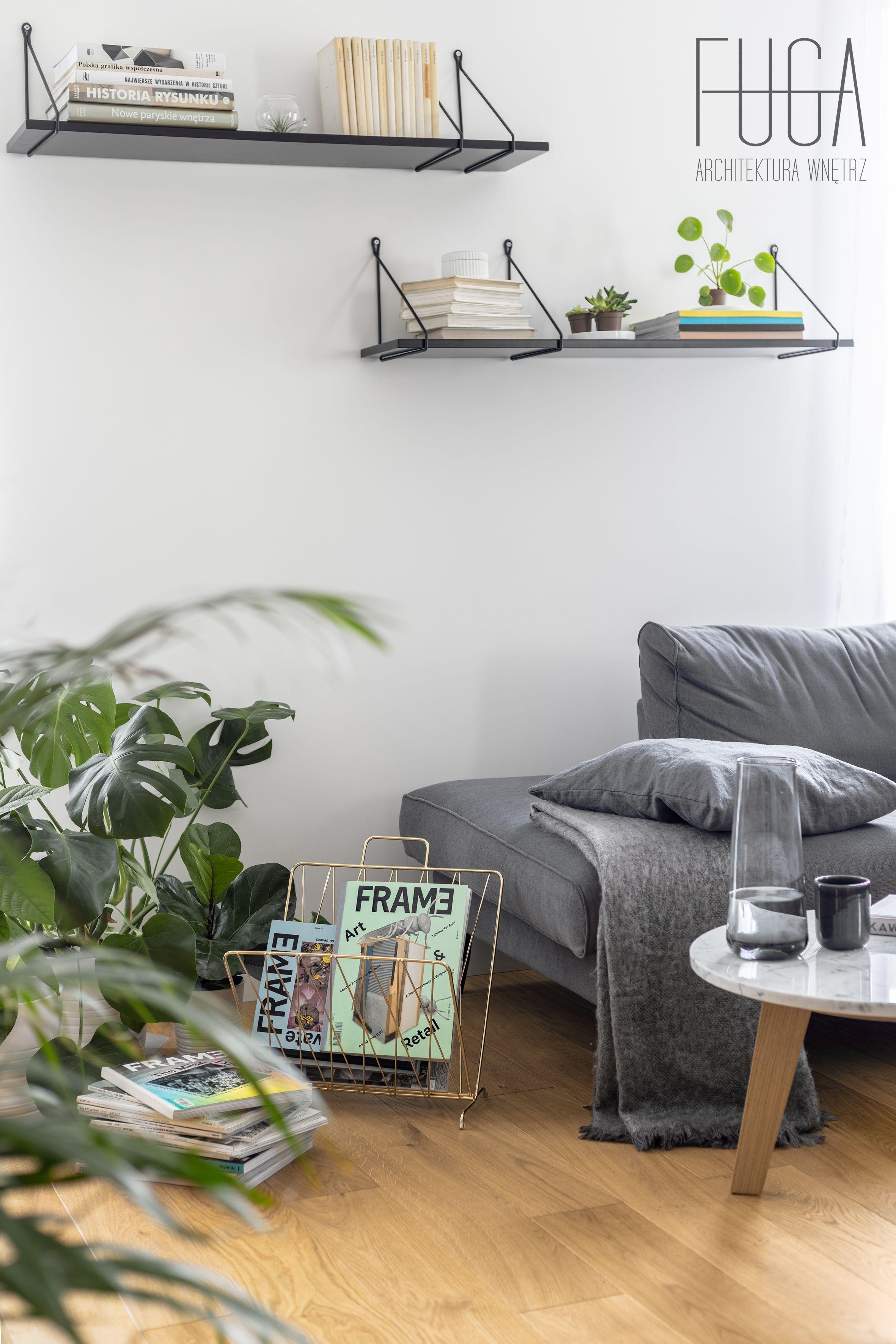 Living room in Warsaw #livingroom #livingroomideas #greysofa #comfortablesofa #sofaideas #woodenfloor #lamps #coffeetable #coffeetableideas #interiordesign #designideas #minimallivingroom #whiteinterior #decorideas #designflatideas #designideas #lovelyplace #bookshelf #bookshelfideas #whitewall #minimalinteriors #blackandwhite #pillows #flower #interiorwithflower