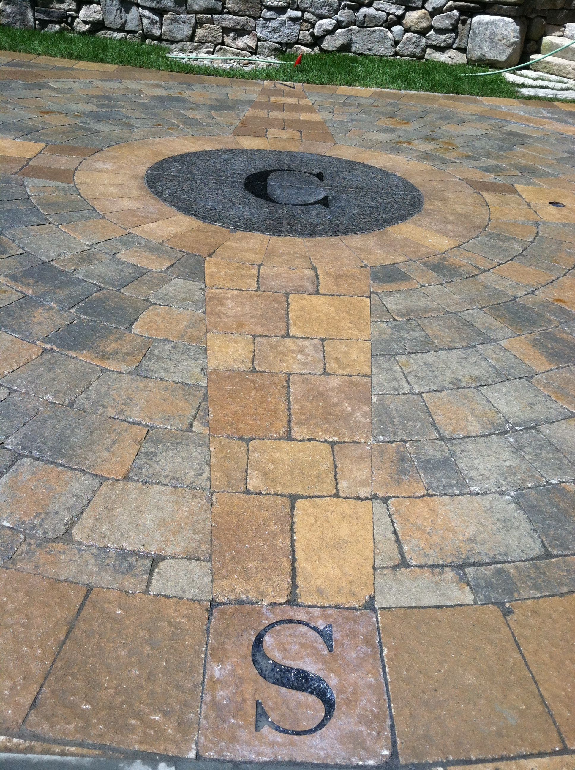 Paver Driveway With Custom Compass Rose And Corinthian