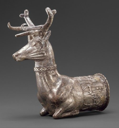 Hittite rhyton terminating in the forepart of a stag (14th/13th century BCE), silver inlayed with gold. The scene inlayed along the mouth of the drinking vessel shows a religious ceremony with a ritual libation. On display at Metropolitan Museum of Art, NYC
