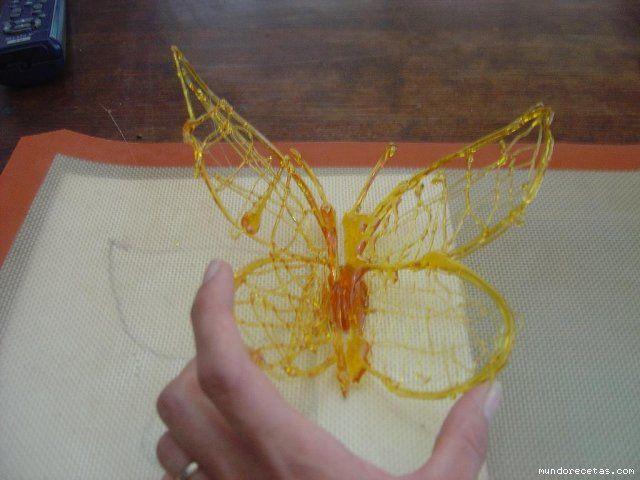 Como hacer mariposas de papel para decorar mariposa de caramelo de az car paso a paso foro - Decoracion con caramelo ...
