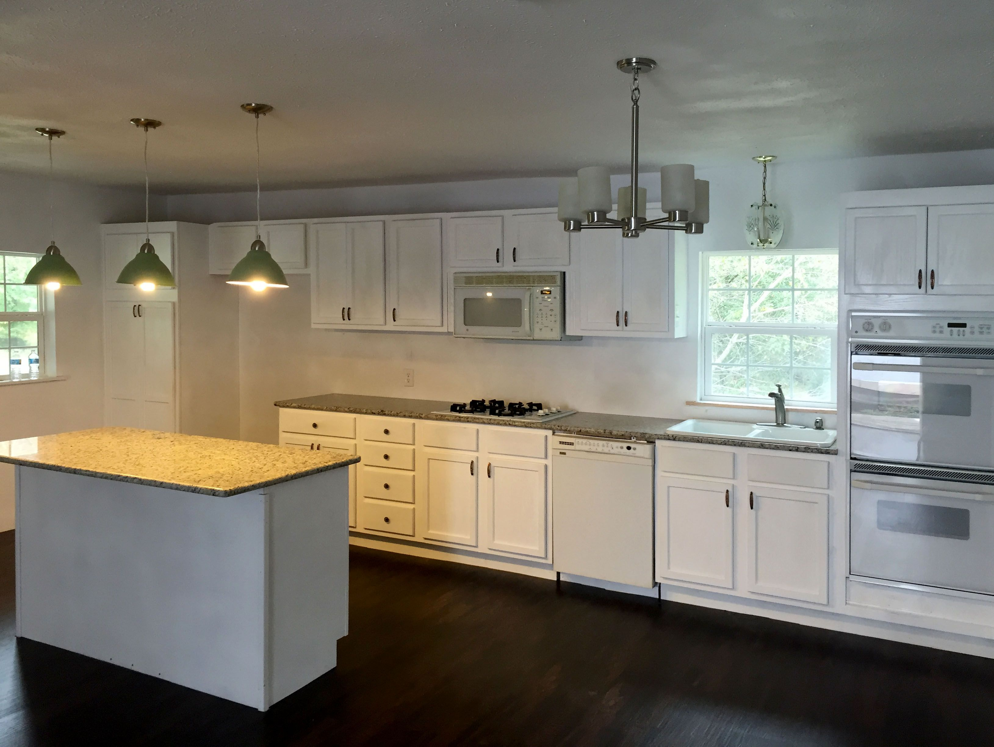 All unfinished oak kitchen cabinets and island, 50 cases ...