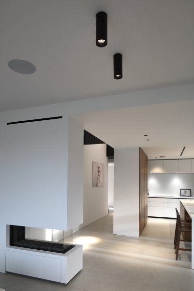 Modern white open living room with kreon holon 80 surface mounted black downlights for Best downlights for living room