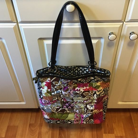 "Vera Bradley patent leather handbagHappy Holiday This Vera Bradley bag have a mix of cloth material and patent leather handle and base , width 14"" height 13 1/2"" base 4 1/2"" Vera Bradley Bags Shoulder Bags"