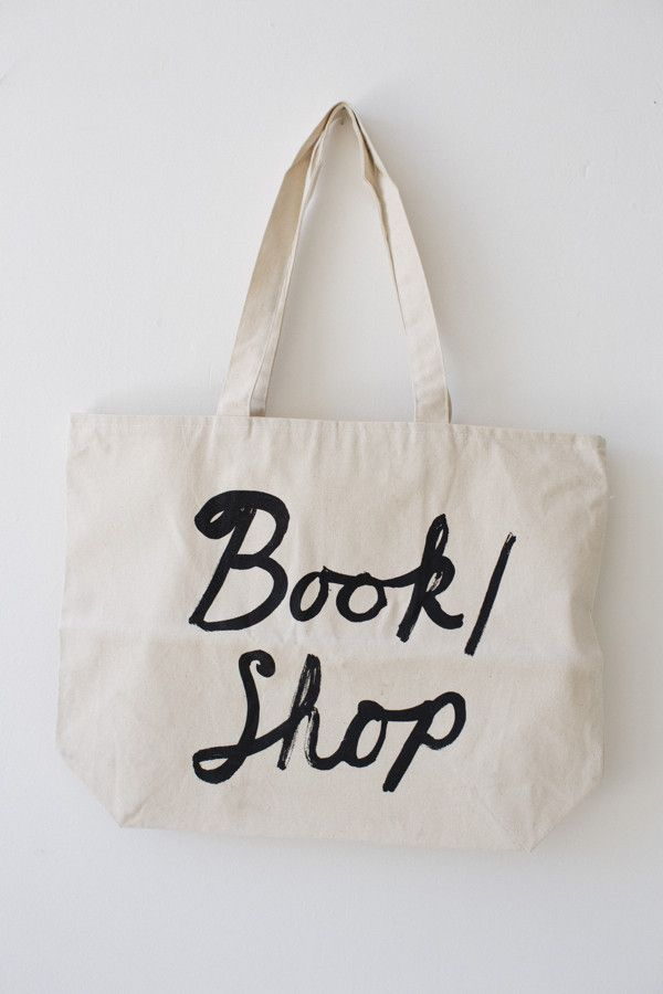 Large Zipper-Top Tote (in Natural or Blue) #zippertop Introducing our latest canvas bag, a big, big shopper tote with a zippered top & 6 1/2 inch square zippered inside pocket. Use it for anything; picnics, laundry, groceries, (we even use it for books!). Natural medium-weight canvas with a large silk-screened BOOK/SHOP logo in black. Printed in Oakland, California. 20″ x 15″ with a generous 4 3/4″ gusset and 10 1/2″ drop handle. #zippertop
