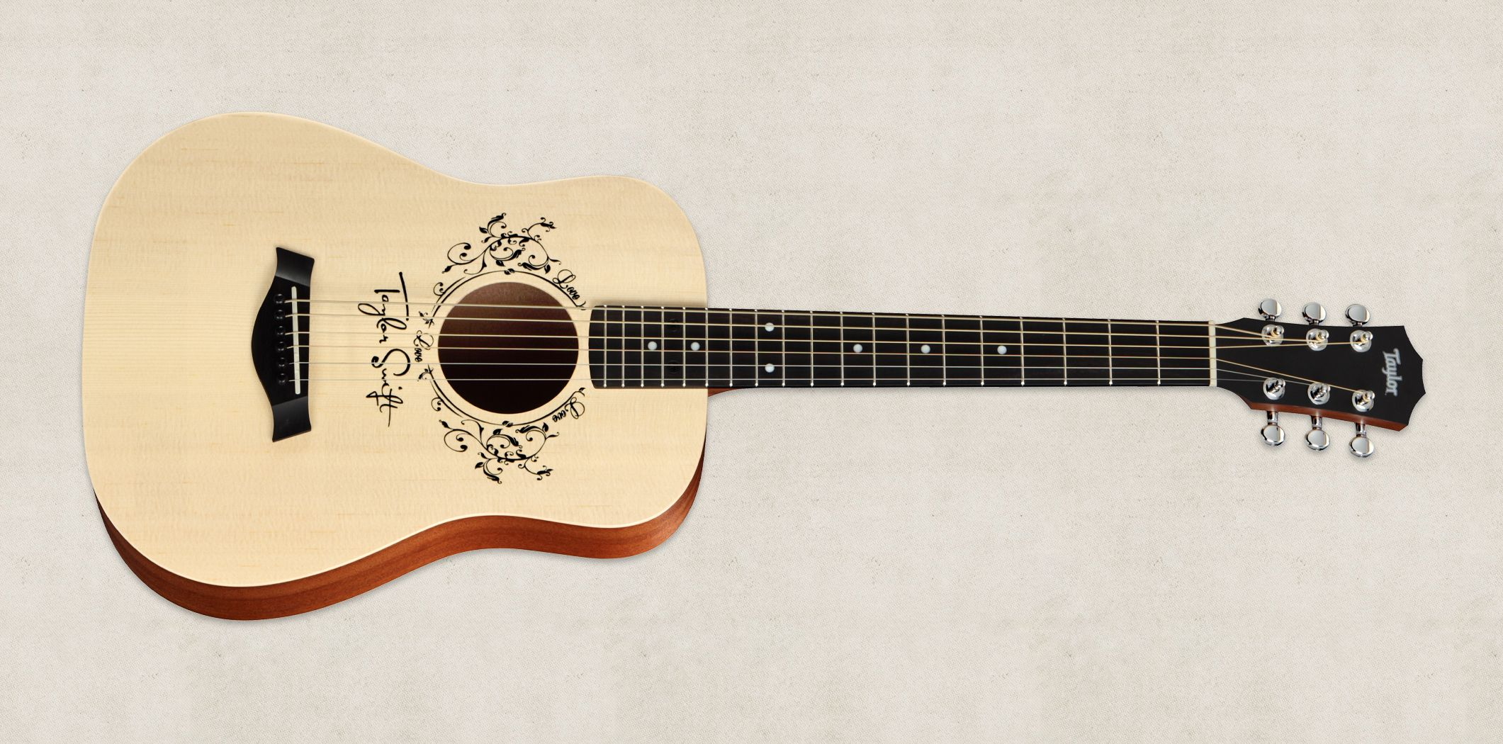 The Taylor Swift Baby Taylor Tsbt Guitar Was Inspired By Swift S Memories Of Writing Songs On Her Own Baby Tay Baby Taylor Taylor Swift Guitar Taylor Guitars