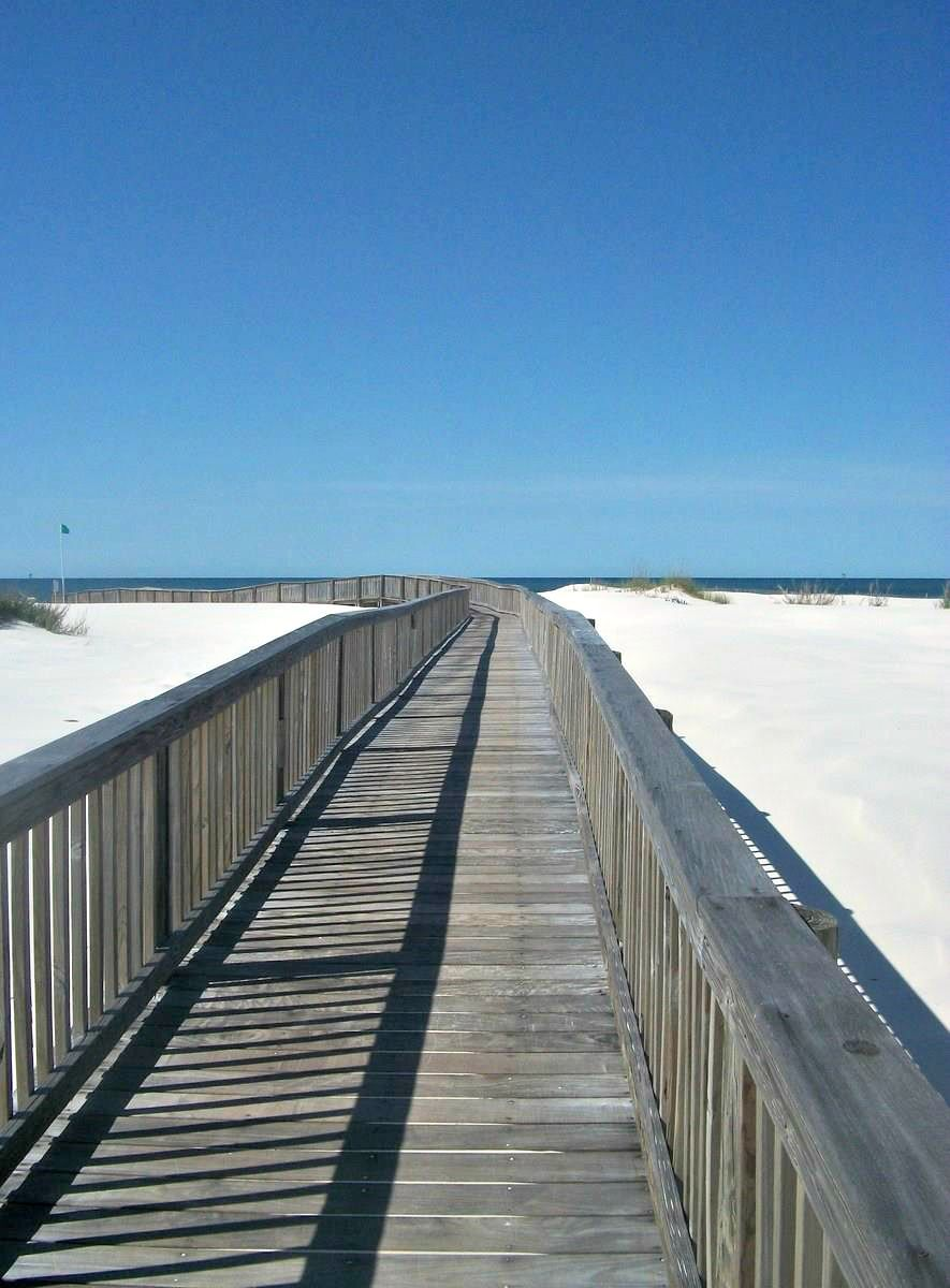 The Beach Beckons From This Inviting Boardwalk