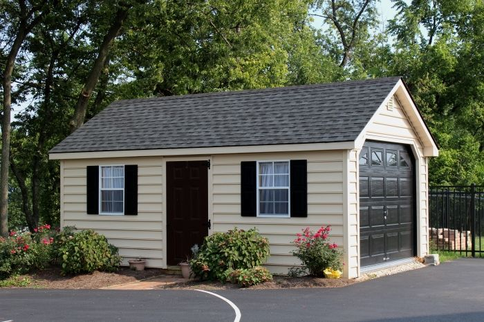 12 X20 Vinyl Garden Shed Garage With Beaded Siding And Sunburst Garage Door Backyard