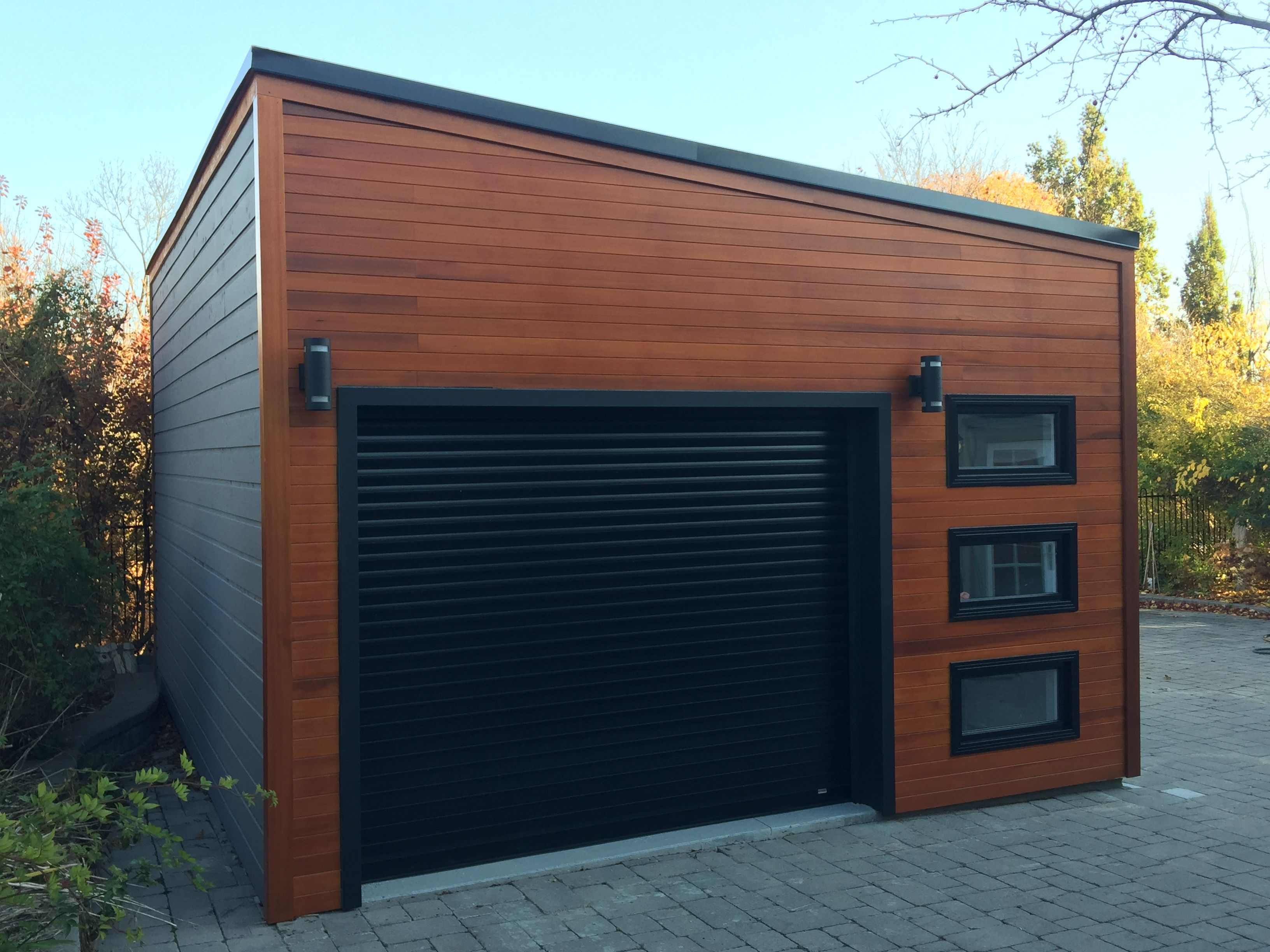 What A Stunning Urban Garage The Black Door And Window Accents Are A Perfect Match For The Beautiful Clear Ced Garage Design Building A Garage Backyard Garage