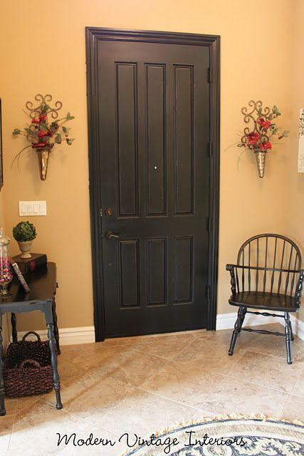 I love the idea of a black interior entryway door
