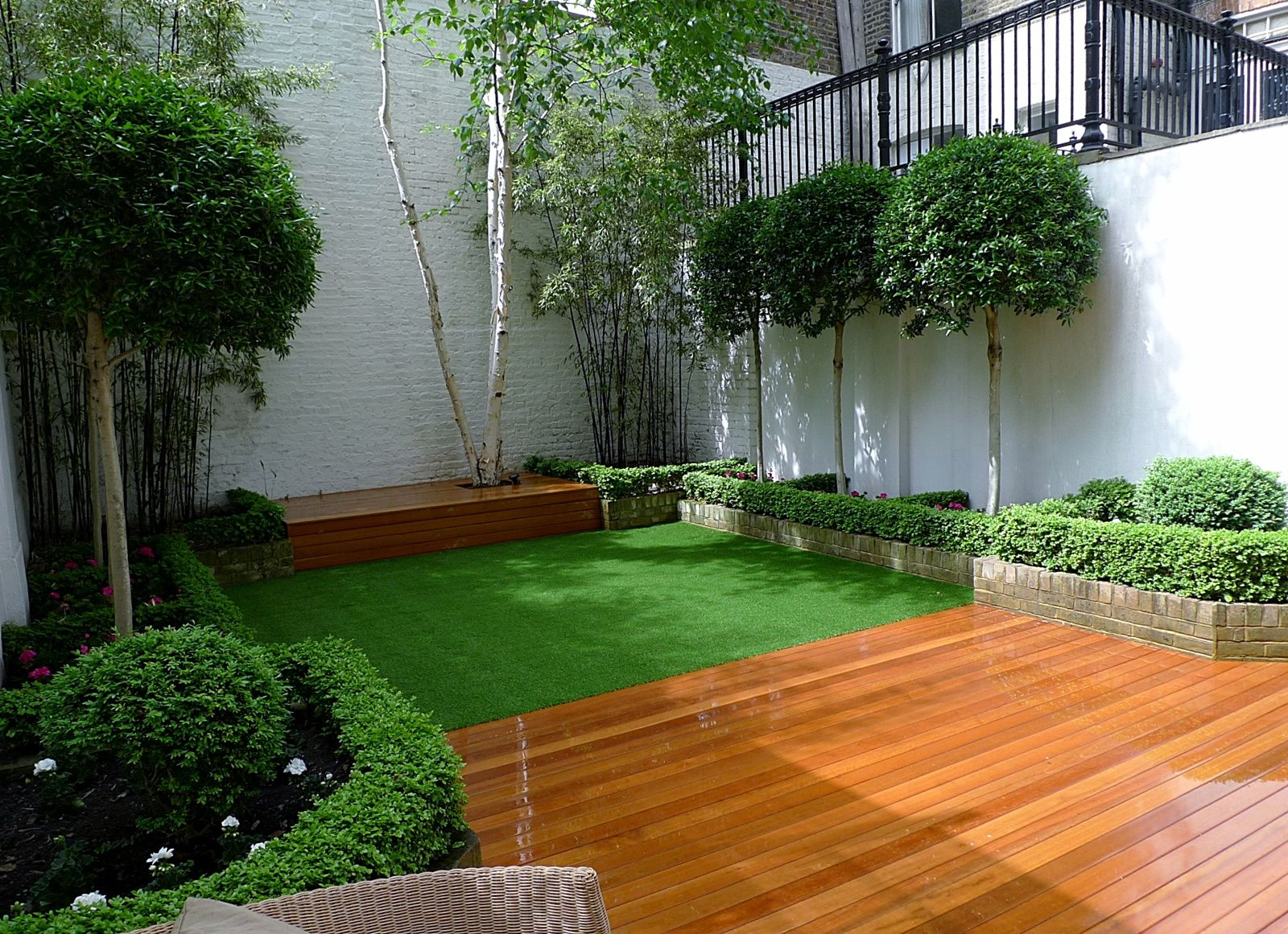 Artificial grass with black decking google search for Small garden lawn designs