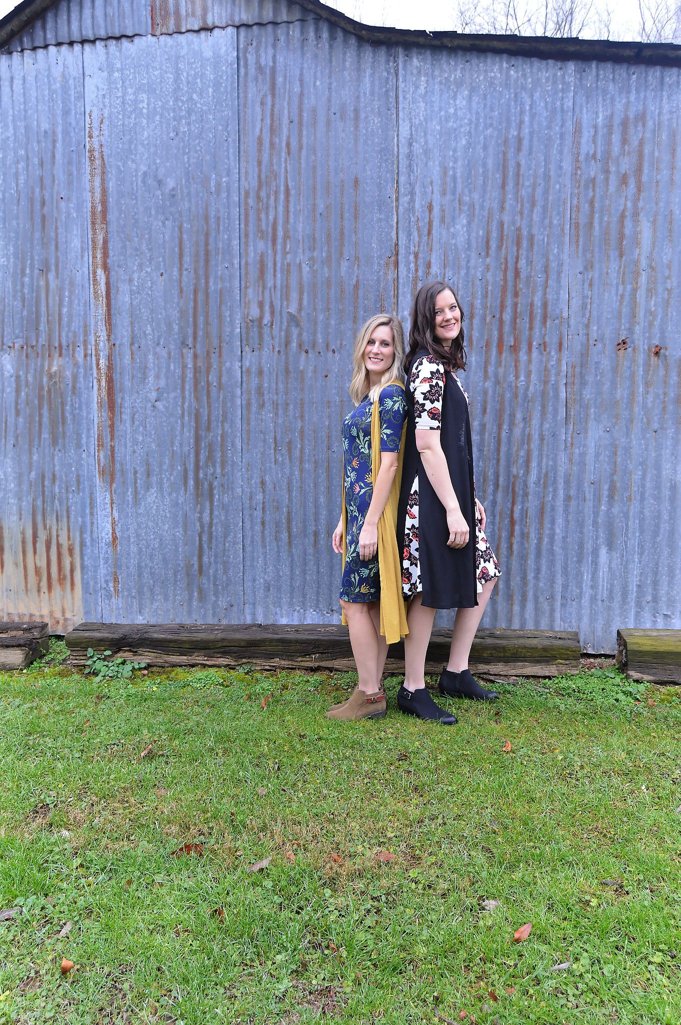 Navy LuLaRoe Julia Dress with scroll print paired with a mustard LuLaRoe Joy.   Black, white, and orange LuLaRoe Nicole dress paired with a black LuLaRoe Joy.   Comfort and beauty at its finest!   #lularoe #lularoejulia #lularoejoy #lularoenicole #style #fashion   *LuLaRoe Besties Katy and Becca