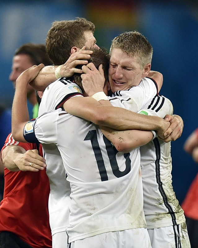 Germany S Thomas Mueller Left Bastian Schweinsteiger Right And Philipp Lahm 16 Embrace After Germany National Football Team Germany Football Soccer Match