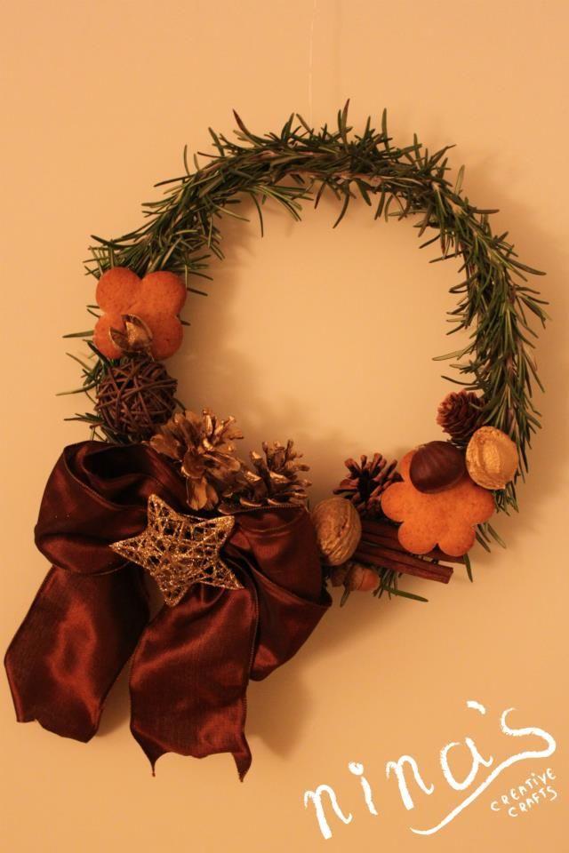 Christmas door rosemary wreath with gingerbread cookies