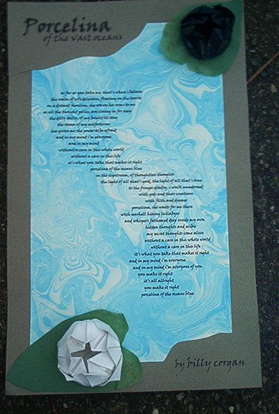 Wall art for a friend. The lyrics to one of her favorite poems, printed on paper I treated with suminagashi ink style, then matted with cut paper and origami water lilies.