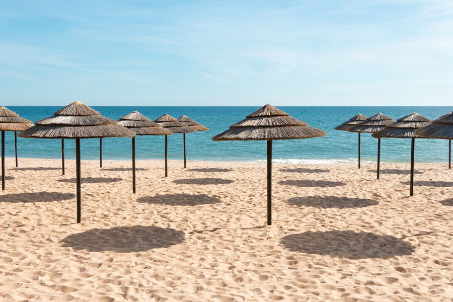 Blue sky, blue sea and parasols at beach in Portugal by Tanya Ustenko on 500px