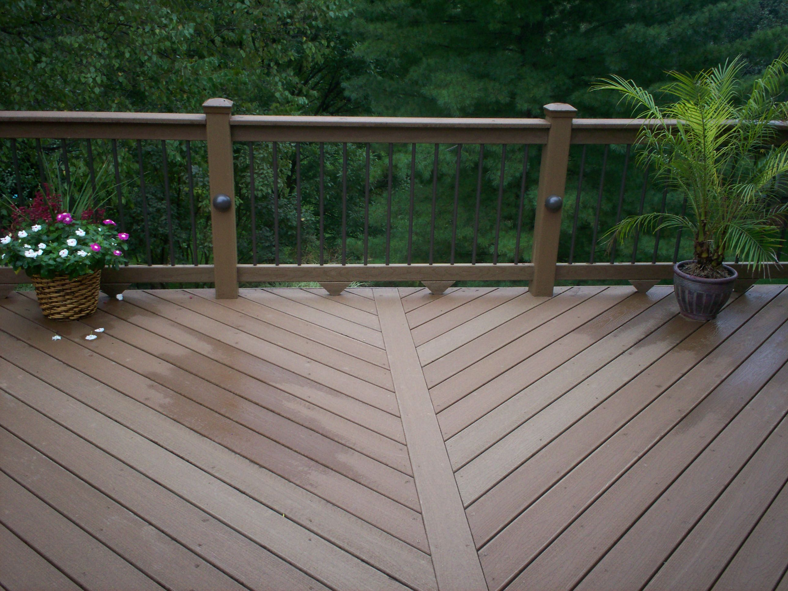 comely deck designs for 2 story house. This deck design includes low maintenance materials  diagonal floor pattern sleek balusters for an open view and rail lights evening ambience St Louis Deck Designs with Floor Board Patterns