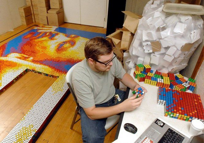Artist and designer Pete Fecteau spent the better part of 2010 creating a mosaic of Dr. Martin Luther King Jr. using 4,242 Rubik's Cubes. The mosaic measures 18'6″ by 9'8″ and weighs approximately 1,000 pounds. This was Fecteau's first attempt at using Rubik's Cubes as artistic medium.