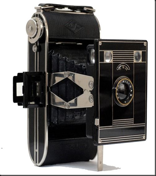 The Agfa Billy-Clack (No. 74)  is an inexpensive fixed focus folding camera with Art Deco styling influences. Agfa had been around in one form or another since 1867 and the camera product range was aimed largely at the mass amateur market. As a result the cameras often mirror those of it's larger competitor, Kodak. The Agfa Billy-Clack, is the equivalent of the Kodak Jiffy, both in performance, appearance and, to a degree, construction. Even the scissor strut folding mechanism is similar.