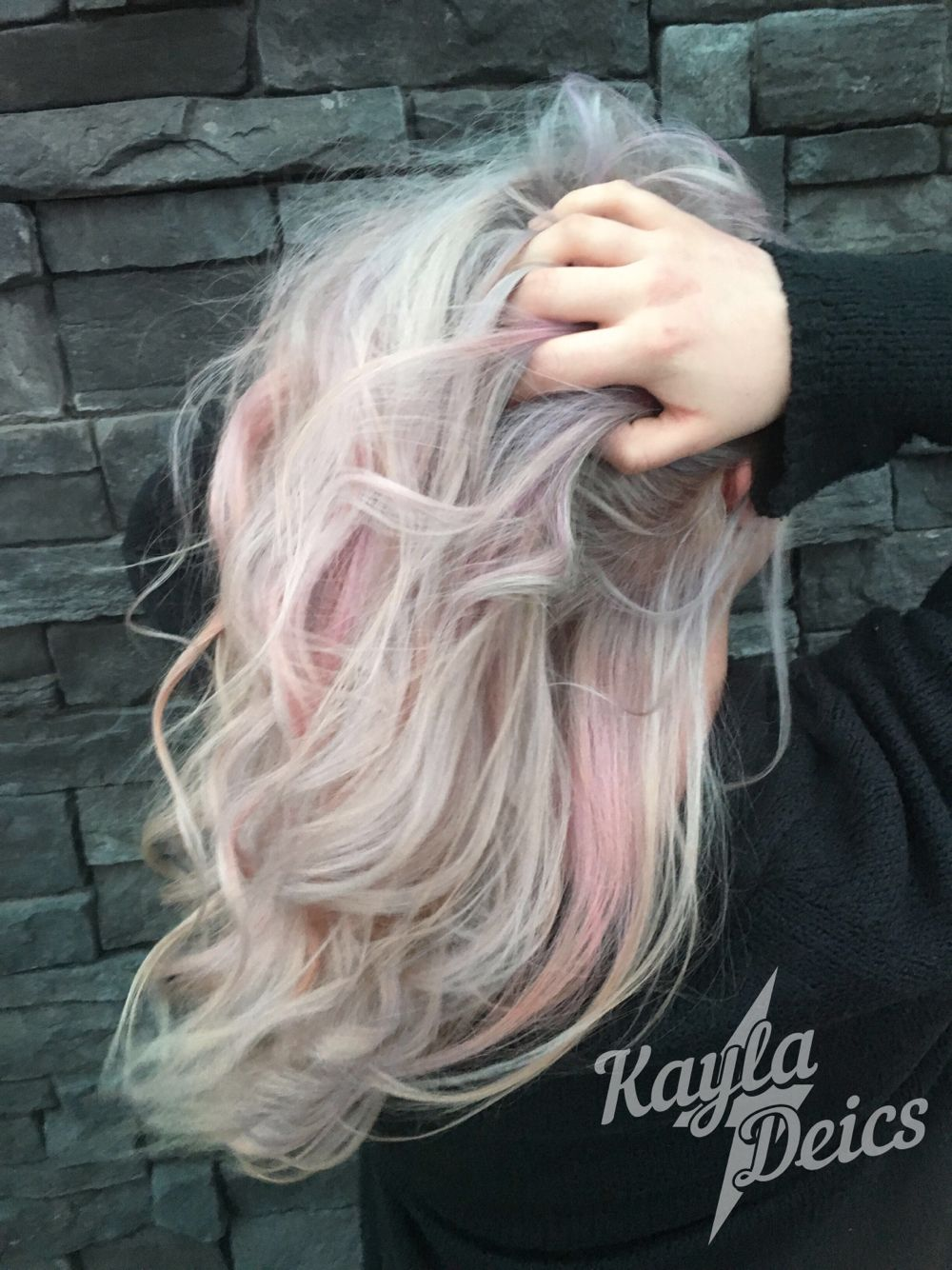 Platinum blonde with pink and purple candy accents hair