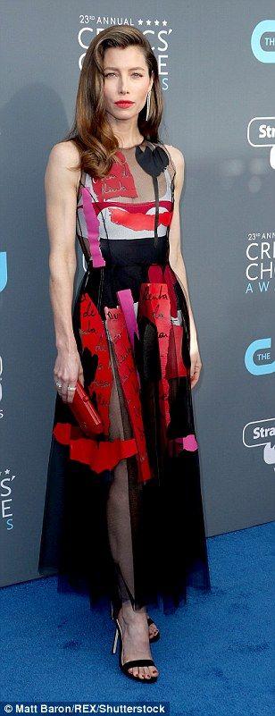 Sheer appeal: Jessica Biel, 35, sported a red, pink, black and white frock Oscar De La Ren...