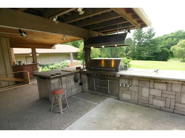 Awesome outdoor kitchen with viking grill refrigerator for Viking outdoor kitchen