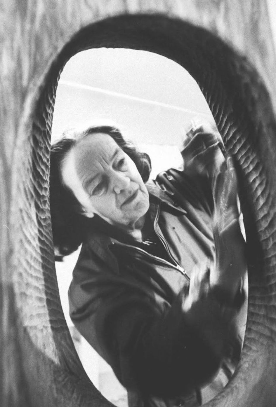 English Sculptor Barbara Hepworth making walnut carving in her studio