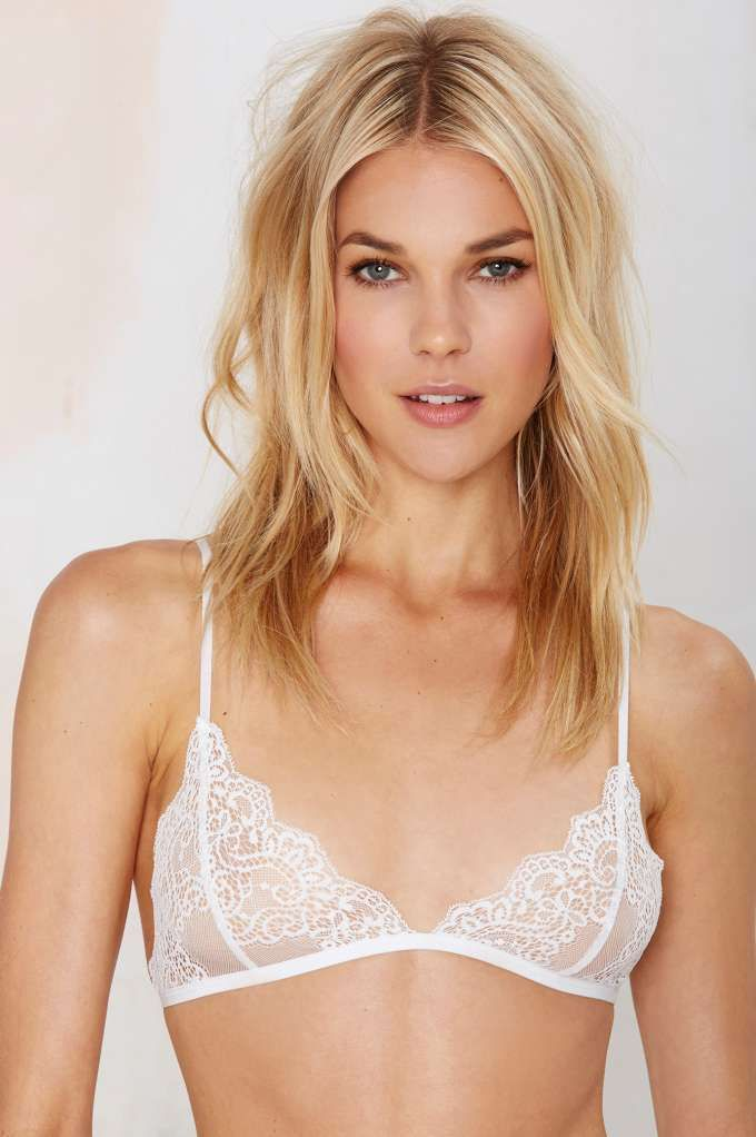 7185ef8b65 Kill it every time in this sheer white lace bralette featuring floral lace  detailing and scalloped trim.